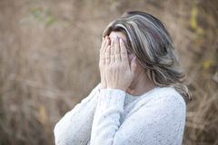 Depressed middle aged woman outdoor Royalty Free Stock Image