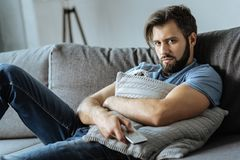 Depressed moody man resting on the sofa Stock Photography