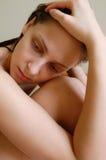 Depressed naked girl Stock Photography