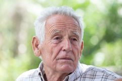 Depressed old man in park Royalty Free Stock Images