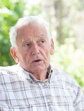 Depressed old man in park Royalty Free Stock Photos
