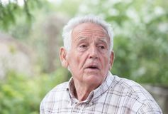 Depressed old man in park Stock Photos