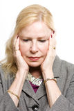 Depressed older business woman Stock Photos