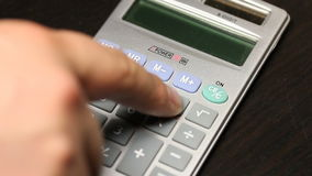 Depressed pushing on calculator stock video footage