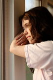Depressed sad  looking out window Royalty Free Stock Photo
