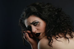 Depressed Sad Thinking Woman on Black Background Stock Photo