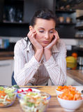 Depressed and sad woman in kitchen Royalty Free Stock Image