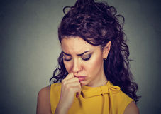 Depressed sad woman leaning head on hand Royalty Free Stock Photography