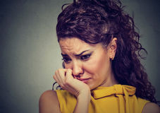 Depressed sad woman leaning head on hand Royalty Free Stock Image