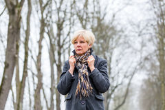 Depressed or sad woman walking in winter stock images