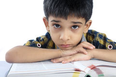 Depressed School boy. Depressed Indian School boy Posing to Camera Stock Photo