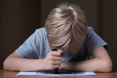 Depressed schoolboy drawing Stock Photo