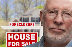 Depressed Senior Man in Front of Foreclosure Sign and House royalty free stock photography