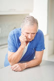 Depressed senior man leaning on table Stock Photos