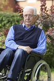 Depressed Senior Man Sitting Outdoors In Wheelchair Royalty Free Stock Photography