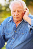 Depressed Senior Man Sitting Outside Royalty Free Stock Photo