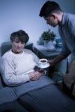 Depressed senior woman with alzheimer Royalty Free Stock Photos