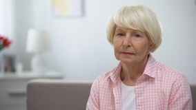 Depressed senior woman looking at camera, social insecurity, low incomes. Stock footage stock video footage