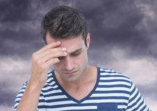 Depressed stressed man against dark clouds. Digital composite of Depressed stressed man against dark clouds Stock Photo