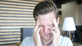 Depressed stressed man having a headache , Feeling awful headache. Depressed young man having a headache , Feeling awful headache , creative designer , curly stock video