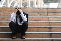 Free Depressed Stressed Young Asian Business Man In Suit With Hands On Head Sitting On Stairs. Unemployment And Layoff Concept Stock Photos - 158616523