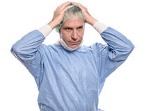 Depressed surgeon in scrubs Royalty Free Stock Photos