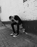 Depressed Teen Boy, Black and White Stock Photo