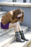 Depressed teen girl. Sitting on stairs Royalty Free Stock Photo