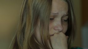 Depressed teen girl crying alone. 4K UHD. Depressed teen girl crying alone. 4K UHD native video stock footage