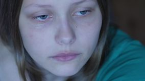 Depressed teen girl crying alone. 4K UHD. Depressed teen girl crying alone. 4K UHD native video stock video footage