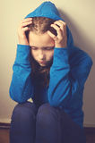 Depressed teen girl Stock Images