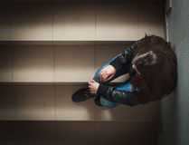 Depressed Teenage Girl. Sitting on the stairs Royalty Free Stock Photos