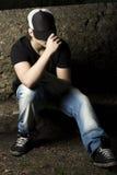 Depressed teenage sitting thinking Royalty Free Stock Photos