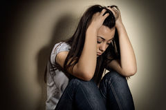 Depressed teenager. Closeup portrait of depressed teenager girl Stock Photo