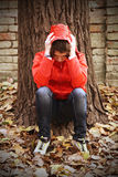 A depressed teenager facing her own problems. Royalty Free Stock Photos