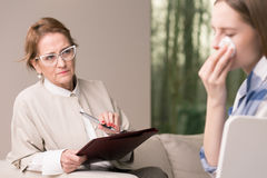 Depressed teenager and helpful psychotherapist Stock Images