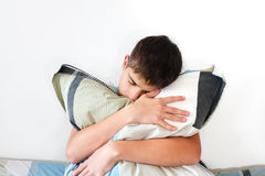 Depressed Teenager With Pillow Stock Photography