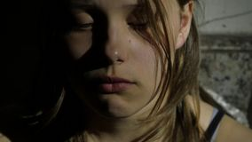 Depressed teenager is sad and guilty. Closeup portrait. 4K UHD. stock footage