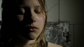 Depressed teenager is sad and guilty. Closeup portrait. 4K UHD. stock video