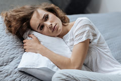 Depressed tired woman lying on the pillow Stock Photo