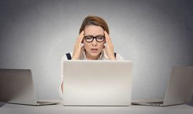 Depressed tired woman siting at desk in front of laptop Royalty Free Stock Photo