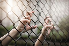 Depressed, trouble and solution. Women hand on chain-link fence. stock photos