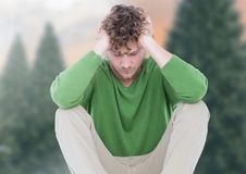 Depressed upset man against trees Stock Photos