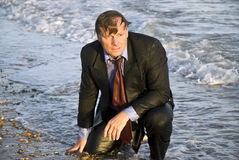 Depressed wet businessman Stock Photos