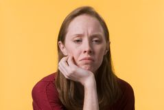 Depressed woman-03. A sad depressed young woman with her hand on her chin Stock Photo