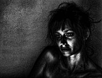 Depressed Woman. Artistic portrait of a sad woman in dramatic lighting Stock Photography