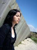 Depressed Woman. I need to rest in this beach it fells like the word is crashing me Royalty Free Stock Images