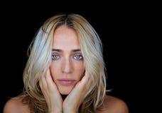 Depressed Woman on black background Stock Photo