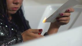 Depressed woman burning photo lighter, broken heart, relations crisis, divorce. Stock footage stock video footage