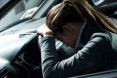 Depressed woman in a car Stock Photos